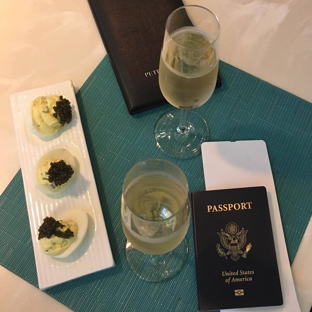 Caviar deviled eggs and bubbly at Petrossian LAX Tom Bradley International Terminal | Photo: @rs__120, Instagram