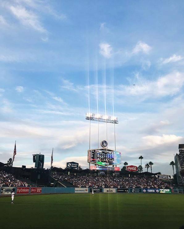 On the field at Dodger Stadium | Instagram by @wheredidlaurago