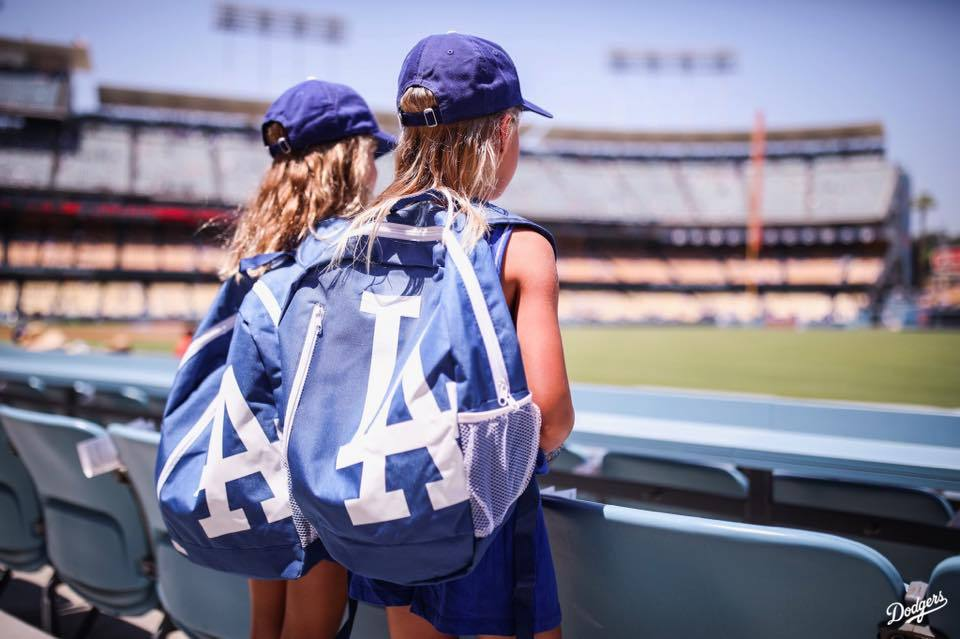 Girls wearing LA Dodgers backpacks at Dodger Stadium