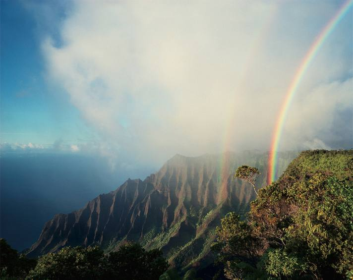 Diane Cook and Len Jenshel, A double rainbow arcs above the jagged cliffs and dense vegetation of Kalalau, the largest valley on Na Pali