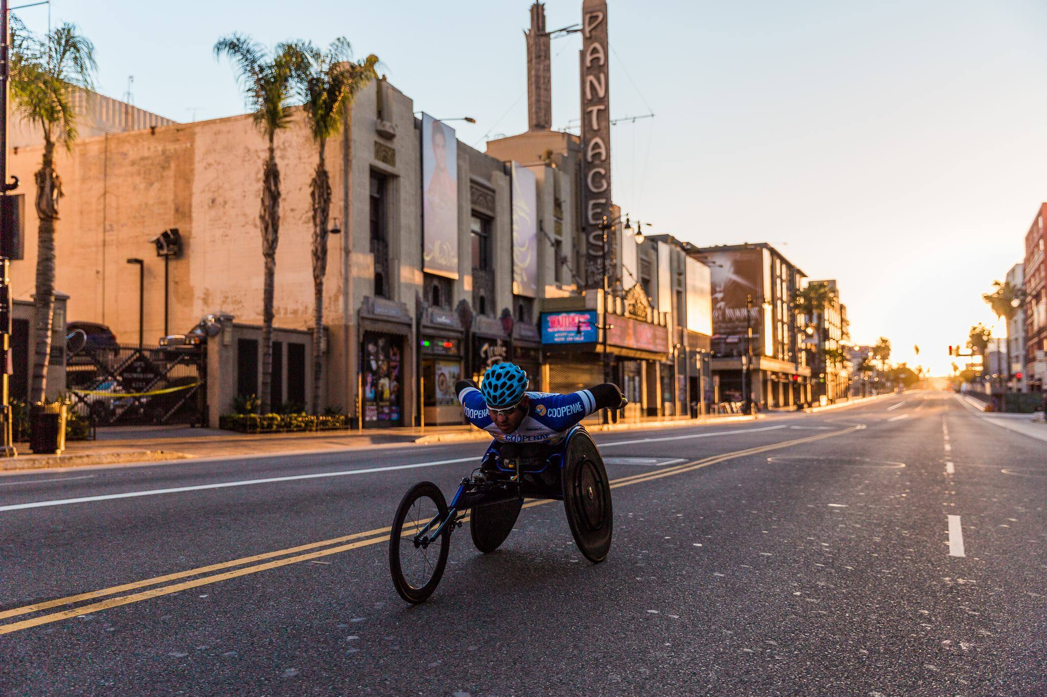 LA Marathon wheelchair racer passes the Pantages Theatre