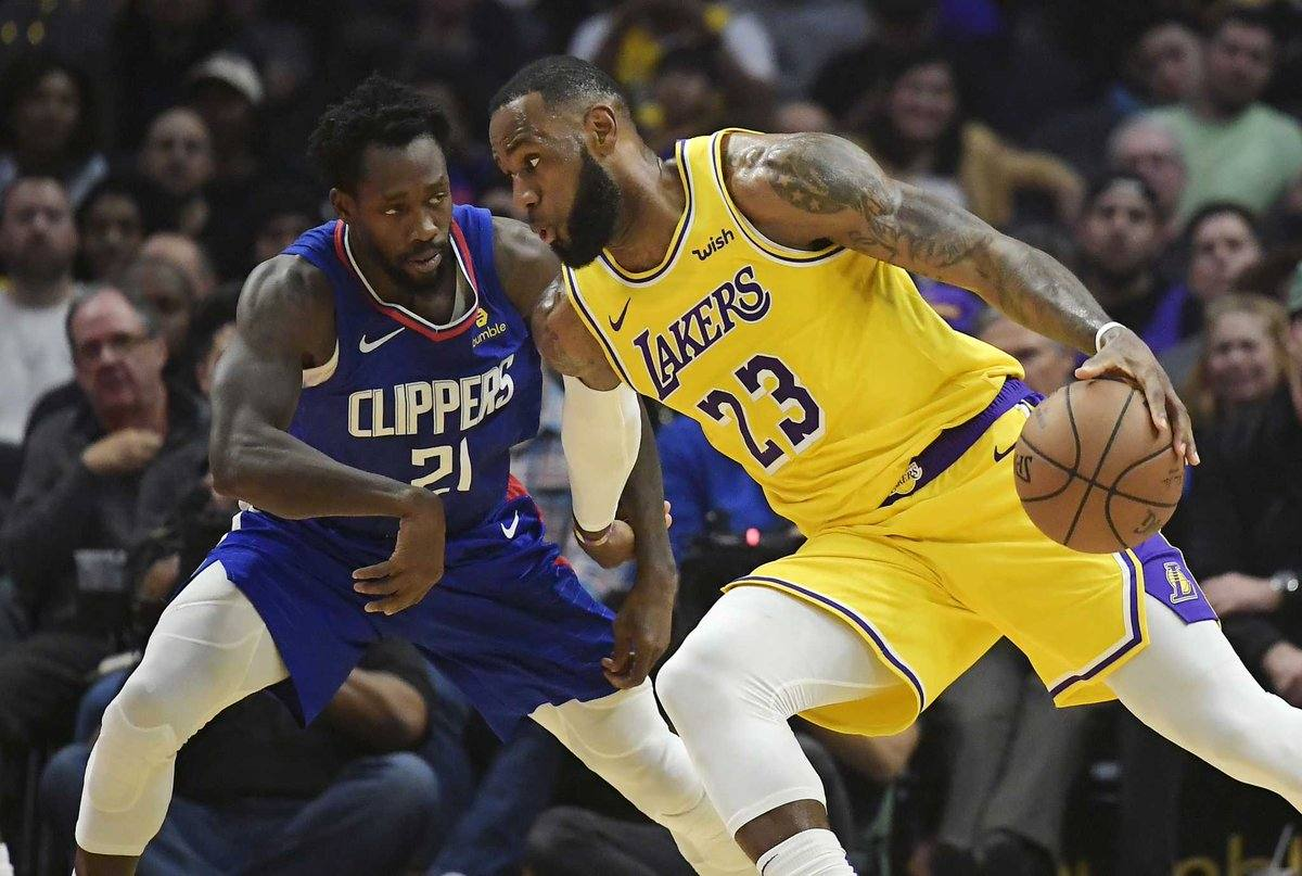 LeBron James drives on Patrick Beverley at STAPLES Center