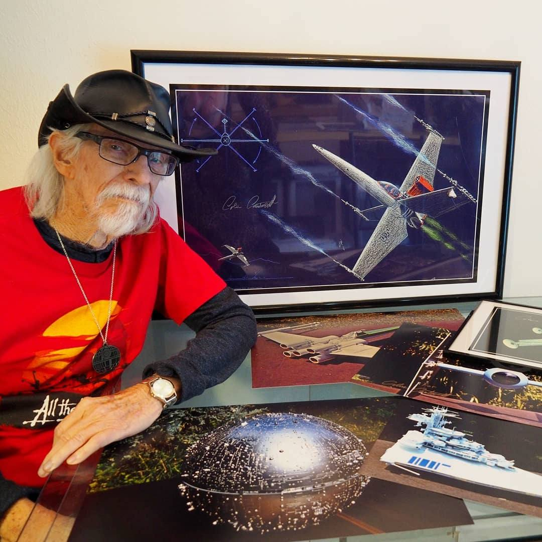 Colin Cantwell with his original Star Warsconcept art