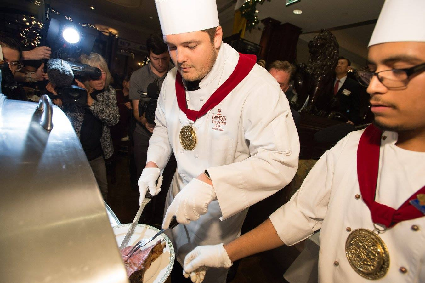 Stanford's Brendon Austin carves prime rib at the Lawry's Beef Bowl