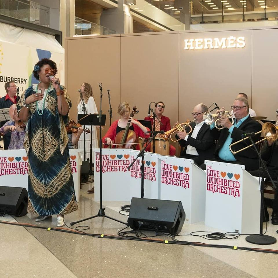 Love Uninhibited Orchestra performs at LAX Tom Bradley International Terminal