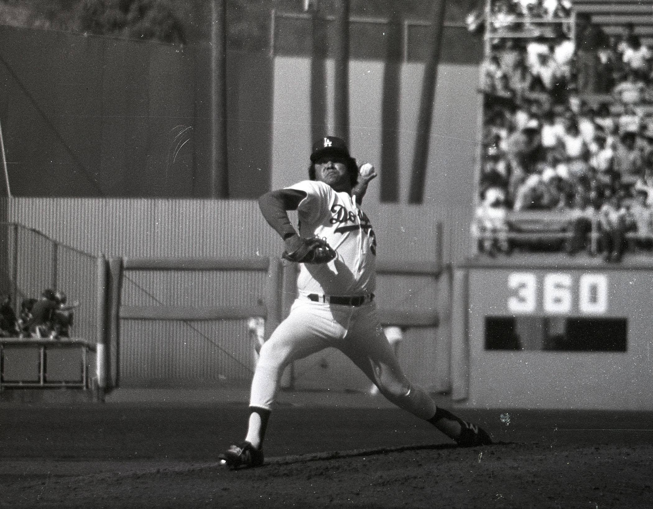 Fernando Valenzuela pitches in an exhibition game at Dodger Stadium in 1981