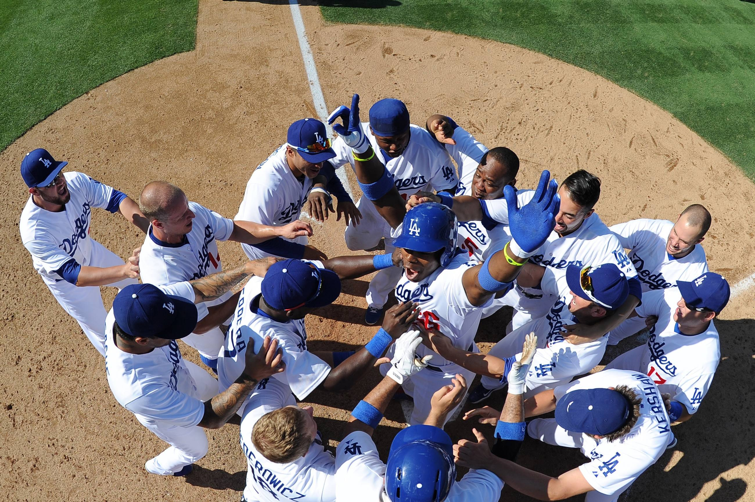 The Dodgers celebrate Yasiel Puig's walk-off home run at Dodger Stadium in 2013