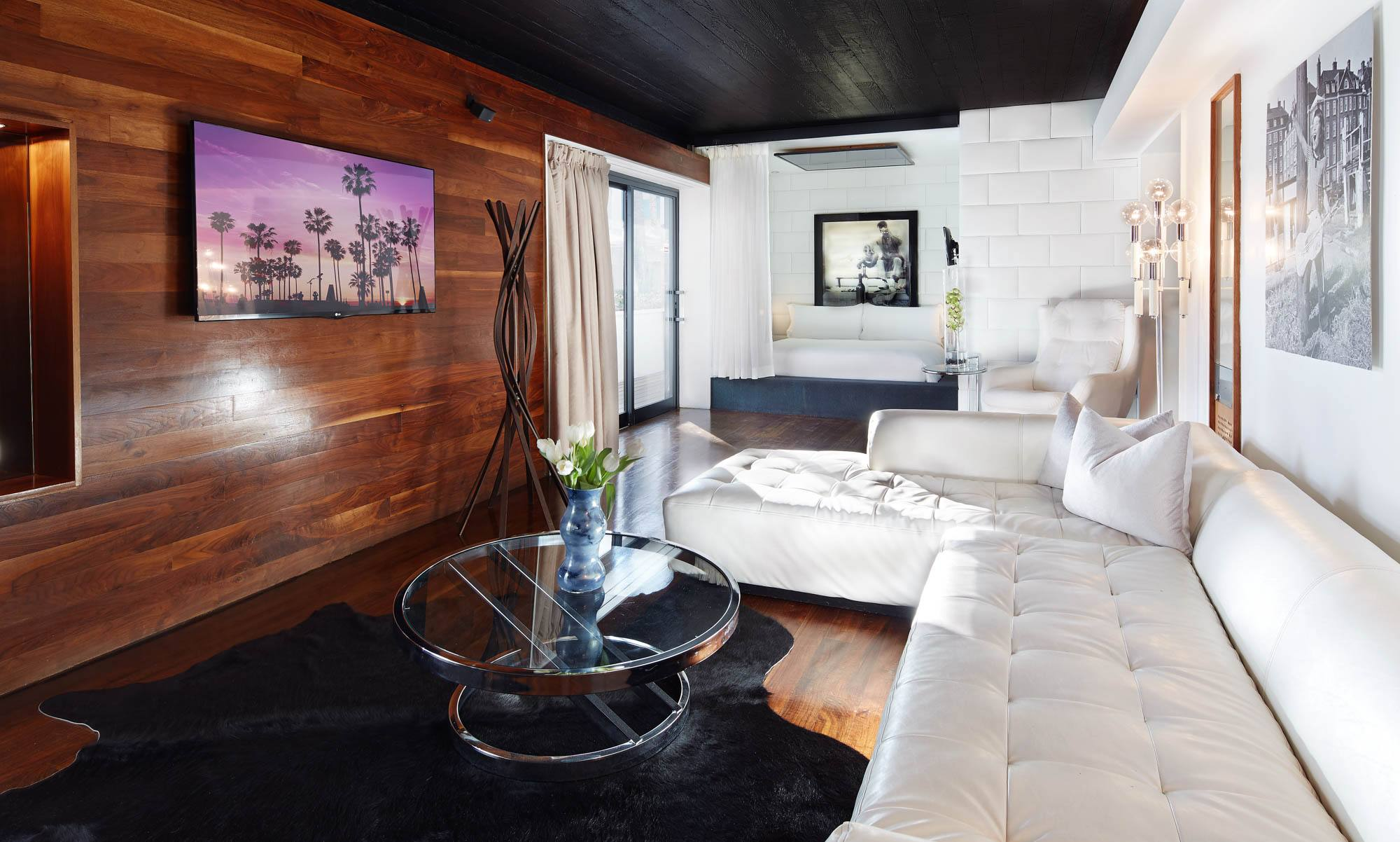 Interior photo of the Hollywood Roosevelt Marilyn Monroe Suite with wood walls and white couch