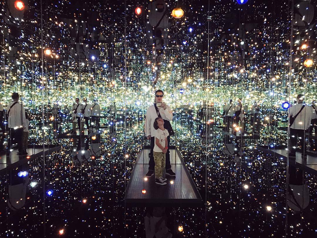 "Dr. Woo and his son inside Yayoi Kusama's ""Infinity Mirrored Room"" at The Broad"