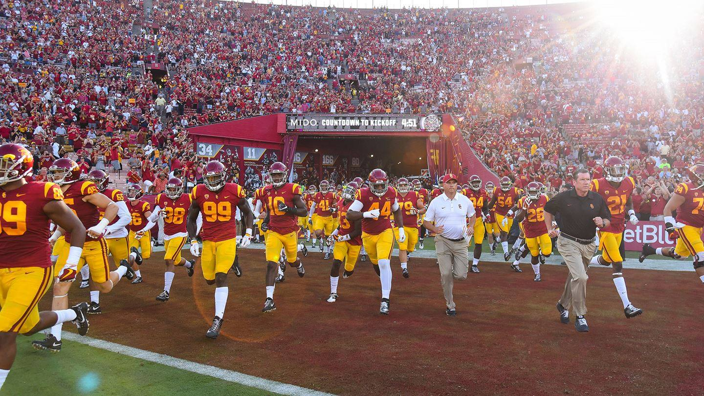 USC Trojans running onto the field at LA Coliseum