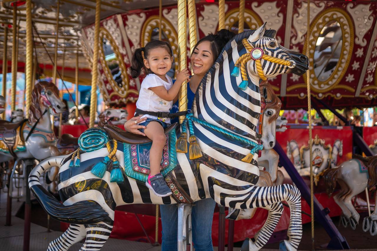 Mother and daughter ride the carousel at the LA County Fair