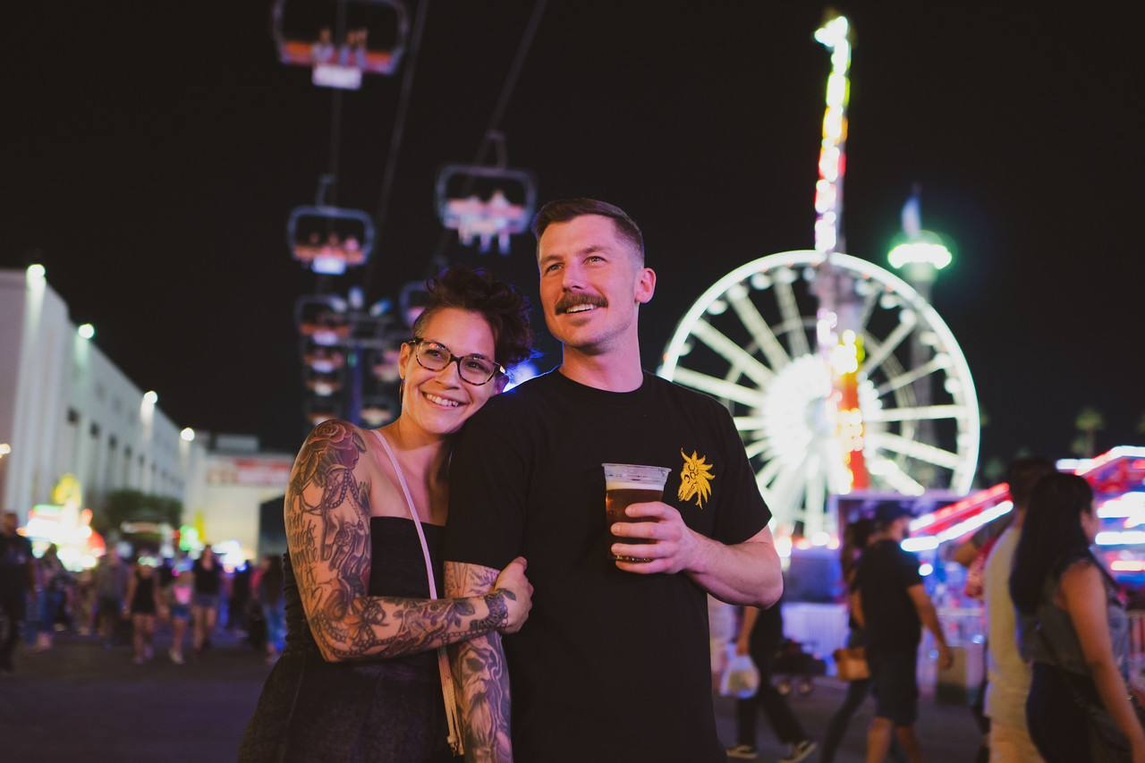 Couple in the Fun Zone at the LA County Fair at night