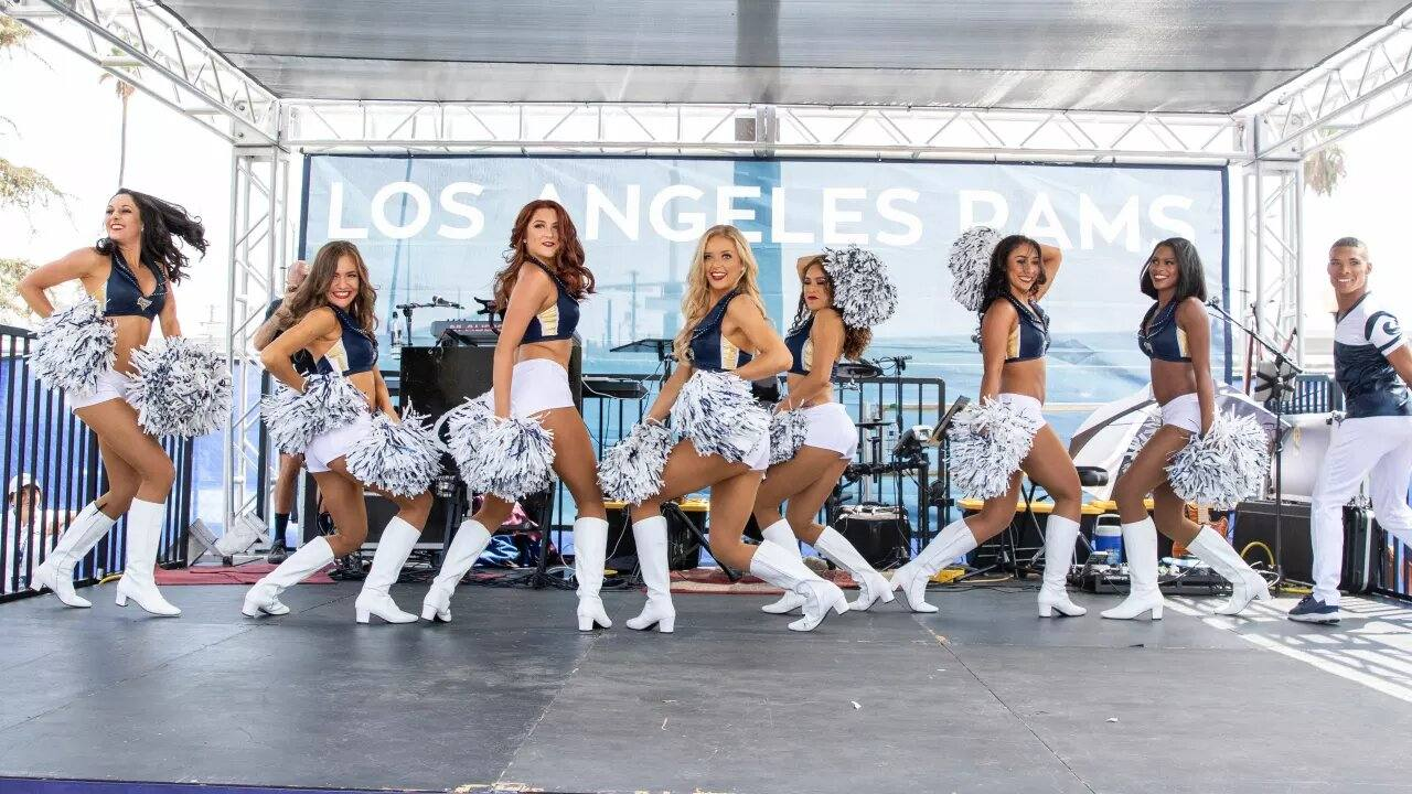 Cheerleaders on stage at LA Rams Fan Fest