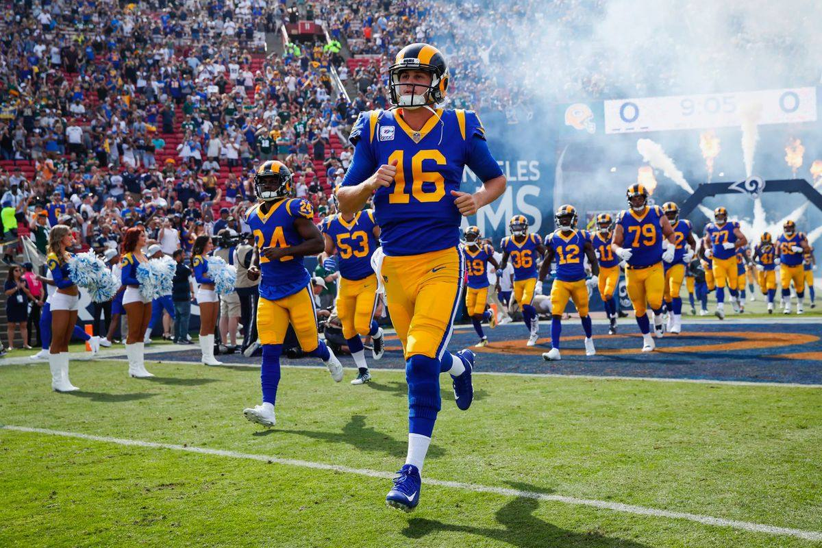 Jared Goff leads the Rams onto the field at the LA Coliseum