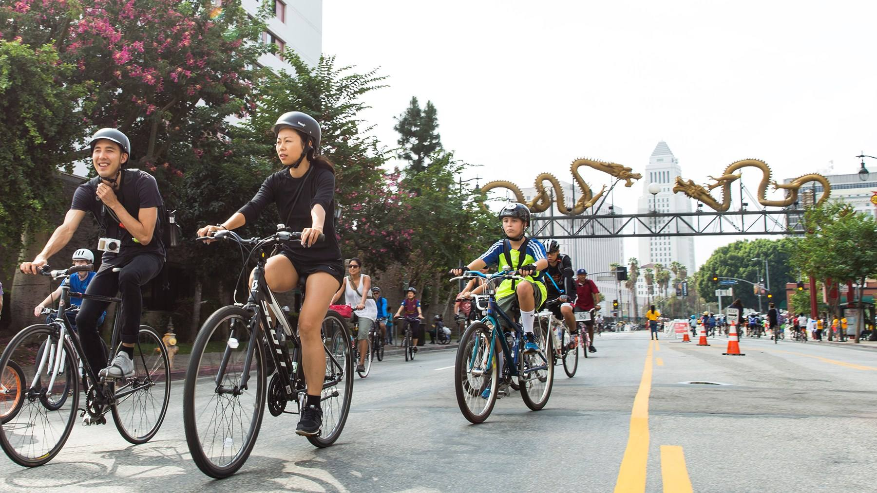 CicLAvia: Heart of LA bicyclists at the Twin Dragon Gateway in Chinatown