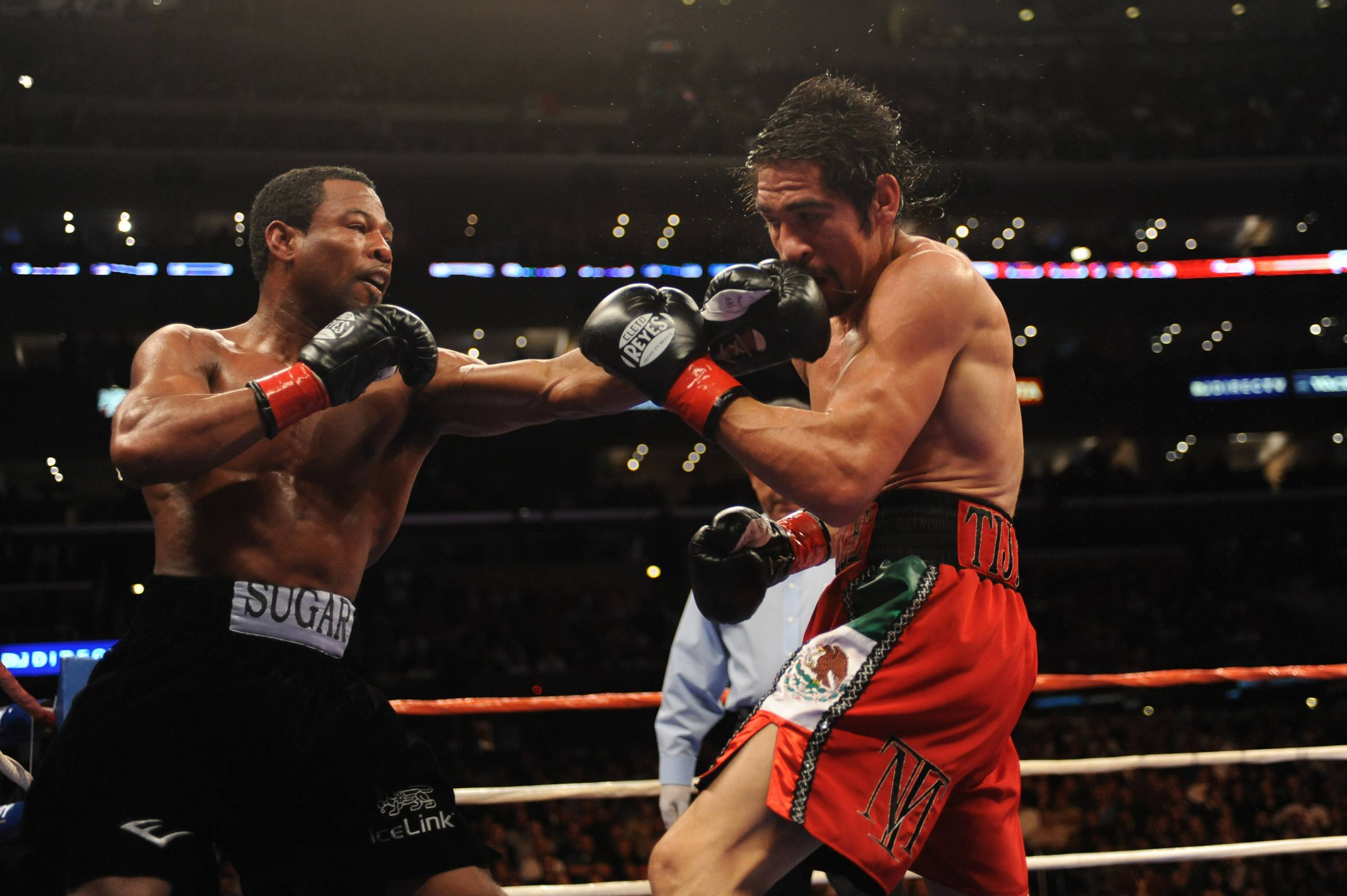 """Sugar"" Shane Mosely lands a punch on Antonio Margarito at STAPLES Center"