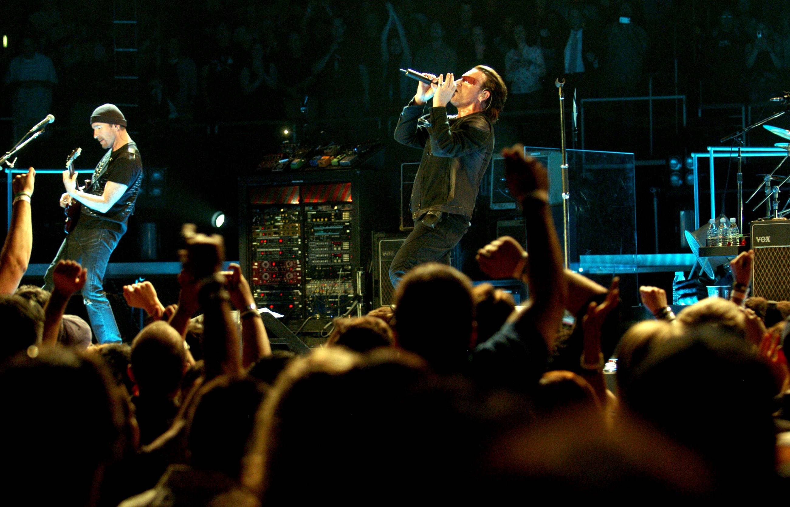 U2's The Edge and Bono performing at STAPLES Center on the Vertigo Tour