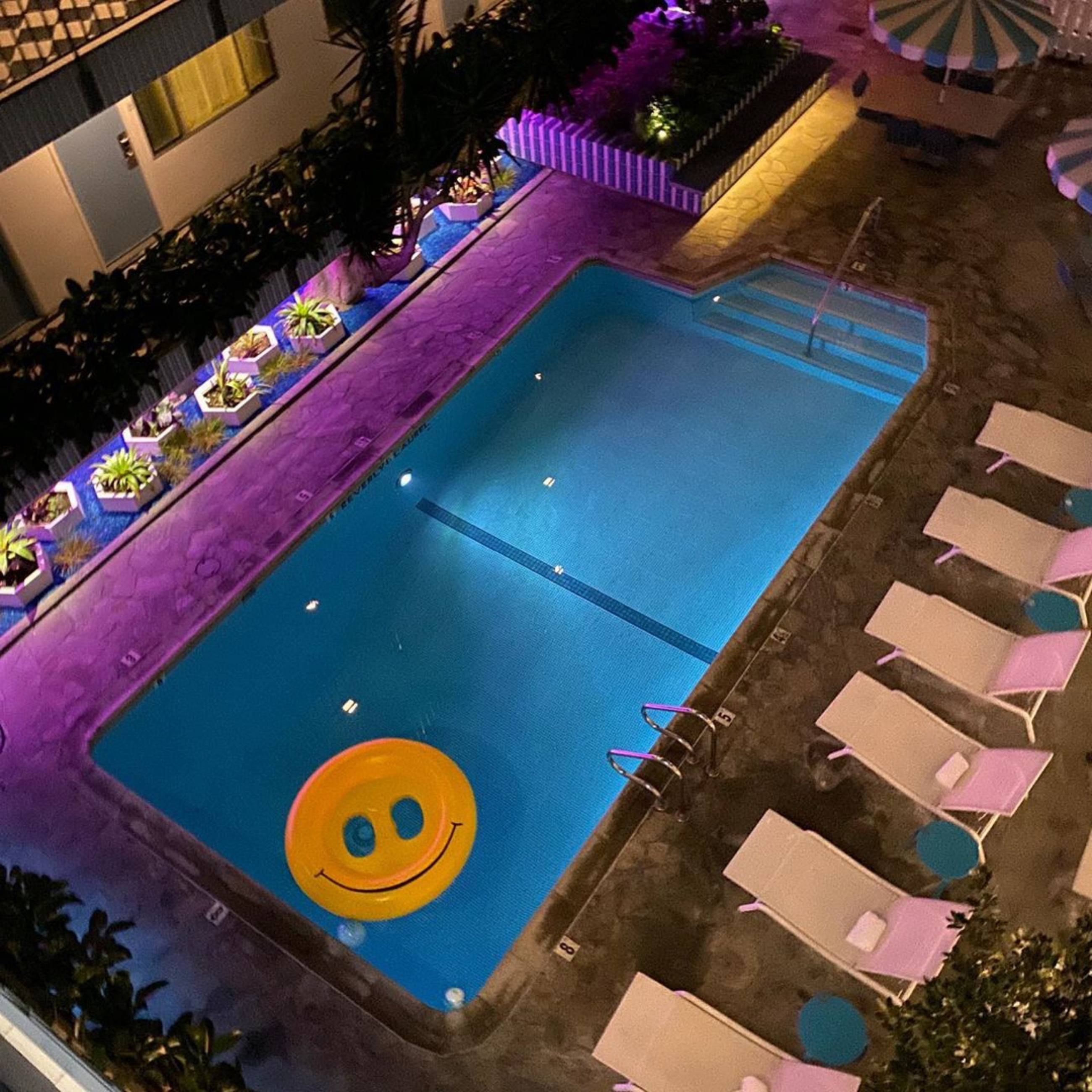 Smiley face floatie in the pool at the Beverly Laurel Motor Hotel