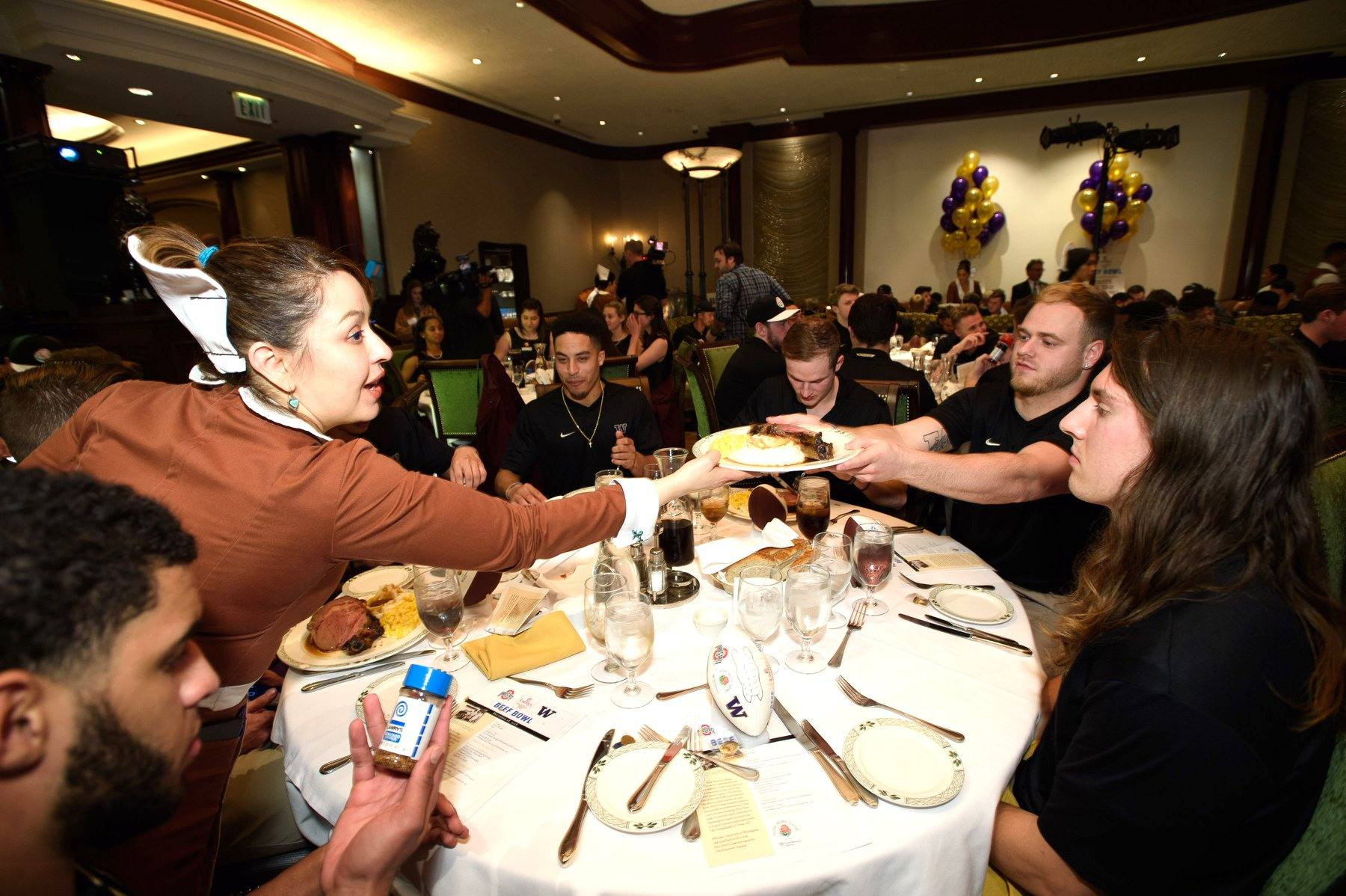 Washington Huskies dining at the Lawry's Beef Bowl in December 2018