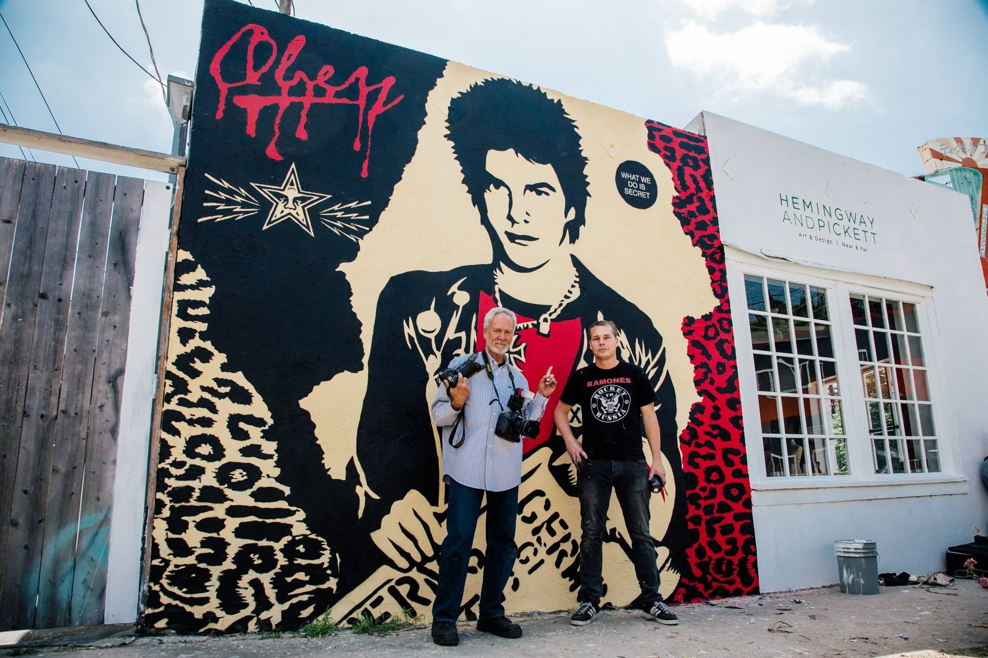 Gary Leonard and Shepard Fairey in front of the restored Darby Crash mural | Photo: Obey Giant