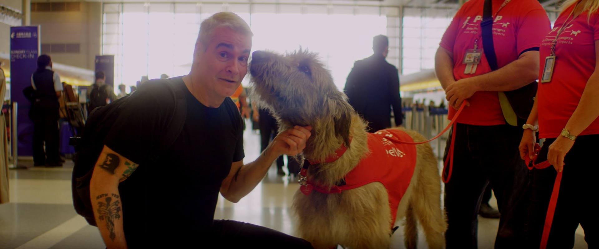 Henry Rollins gets a warm welcome from a PUP Program dog at LAX