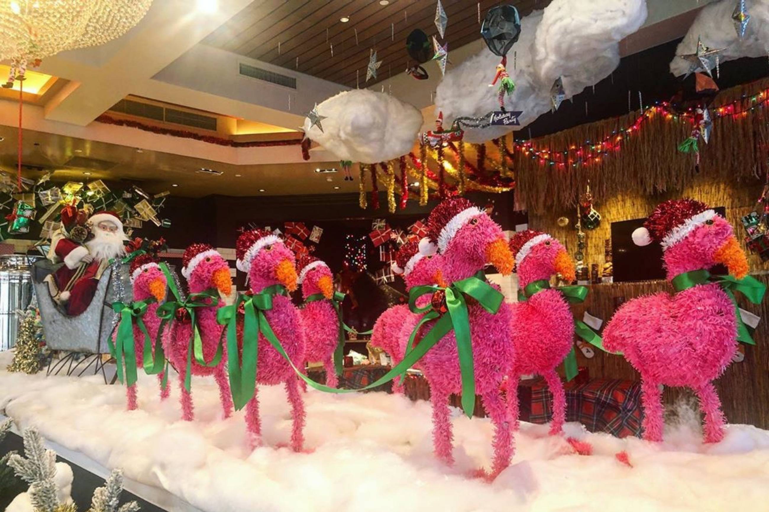 Santa and his flamingos at the Holiday Party Pop-Up Bar in Runway Playa Vista