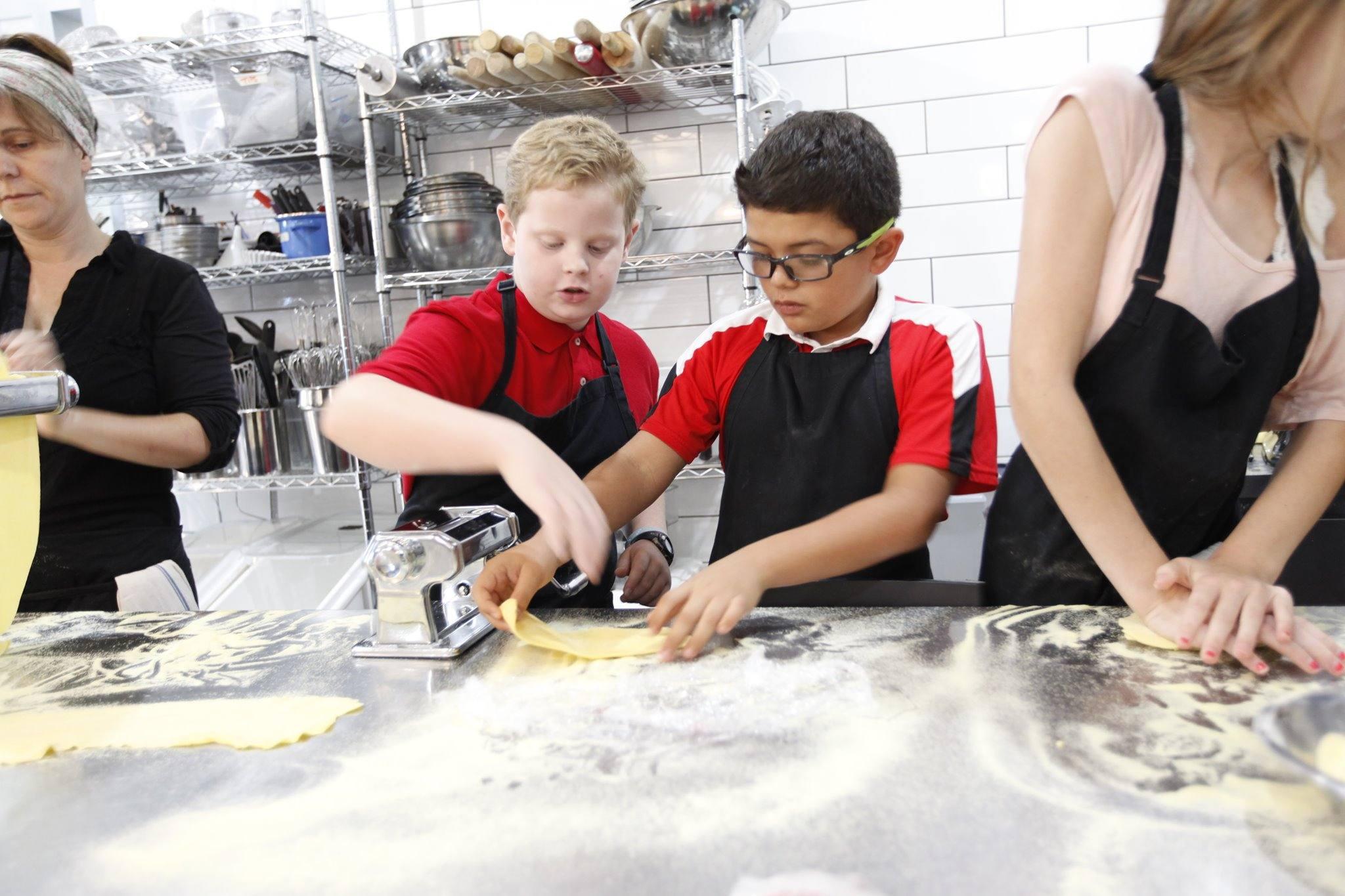 Boys making pasta at The Gourmandise School in Santa Monica