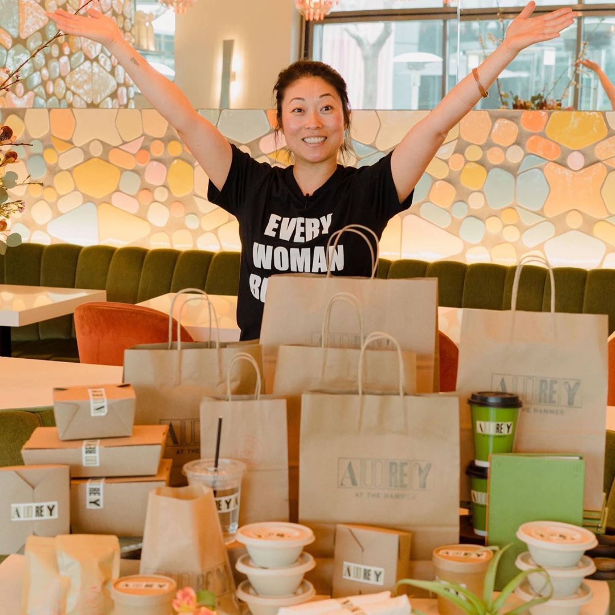 Chef Lisa Giffen with to-go orders and Audrey Provisions bulk items