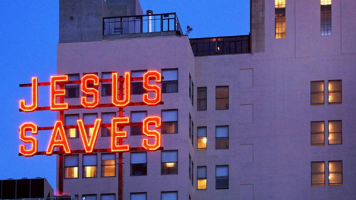 """Jesus Saves"" neon sign at the Ace Hotel 