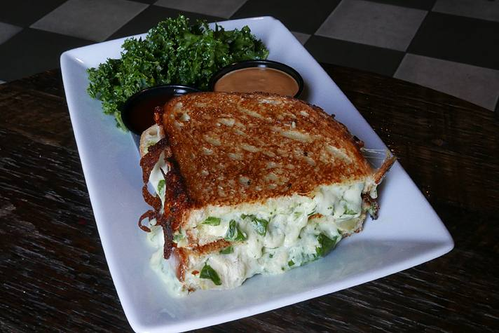 Artichoke spinach dip grilled cheese at Blind Barber | Photo by Joshua Lurie