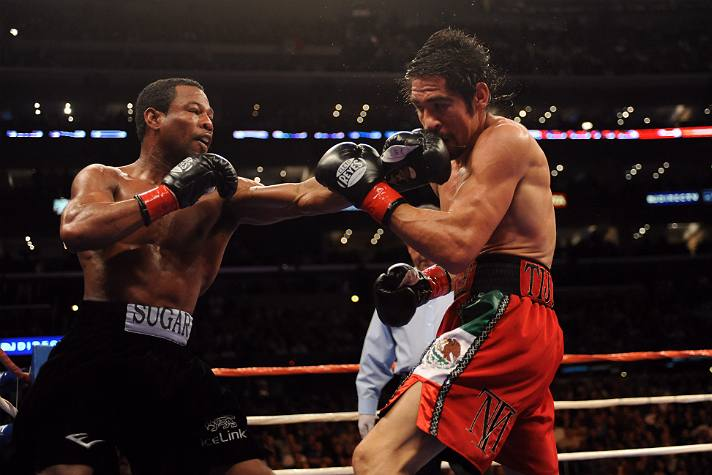 """""""Sugar"""" Shane Mosely lands a punch on Antonio Margarito 