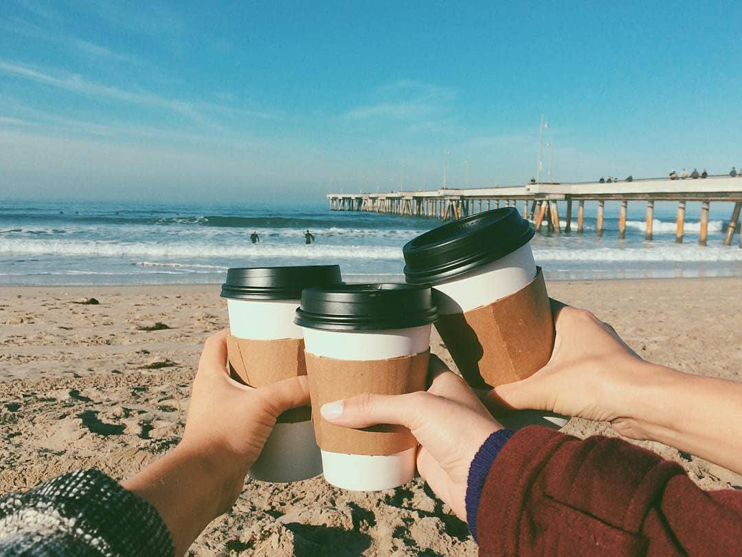 Coffee on the beach from The Cow's End l Instagram by @washingtonsquarevenice