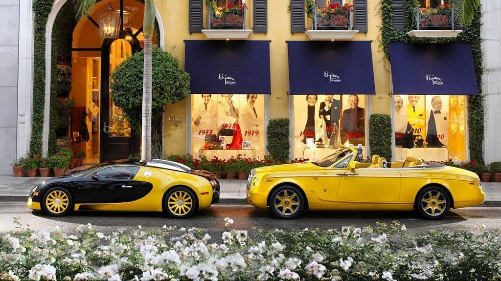 """Bugatti Veyron Grand Sport and Rolls-Royce Phantom Drophead Coupe at the House of Bijan, aka """"the Most Expensive Store in the World"""" 