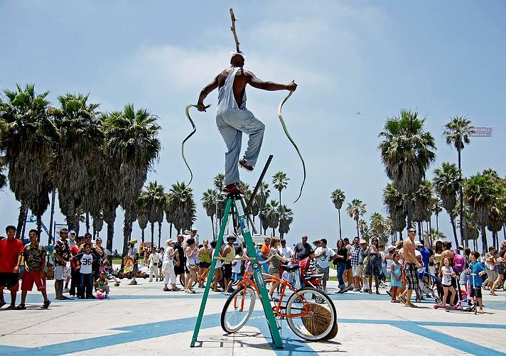 King Solomon the Snake Charmer at Venice Beach   Photo courtesy of Eric Lassiter, Flickr