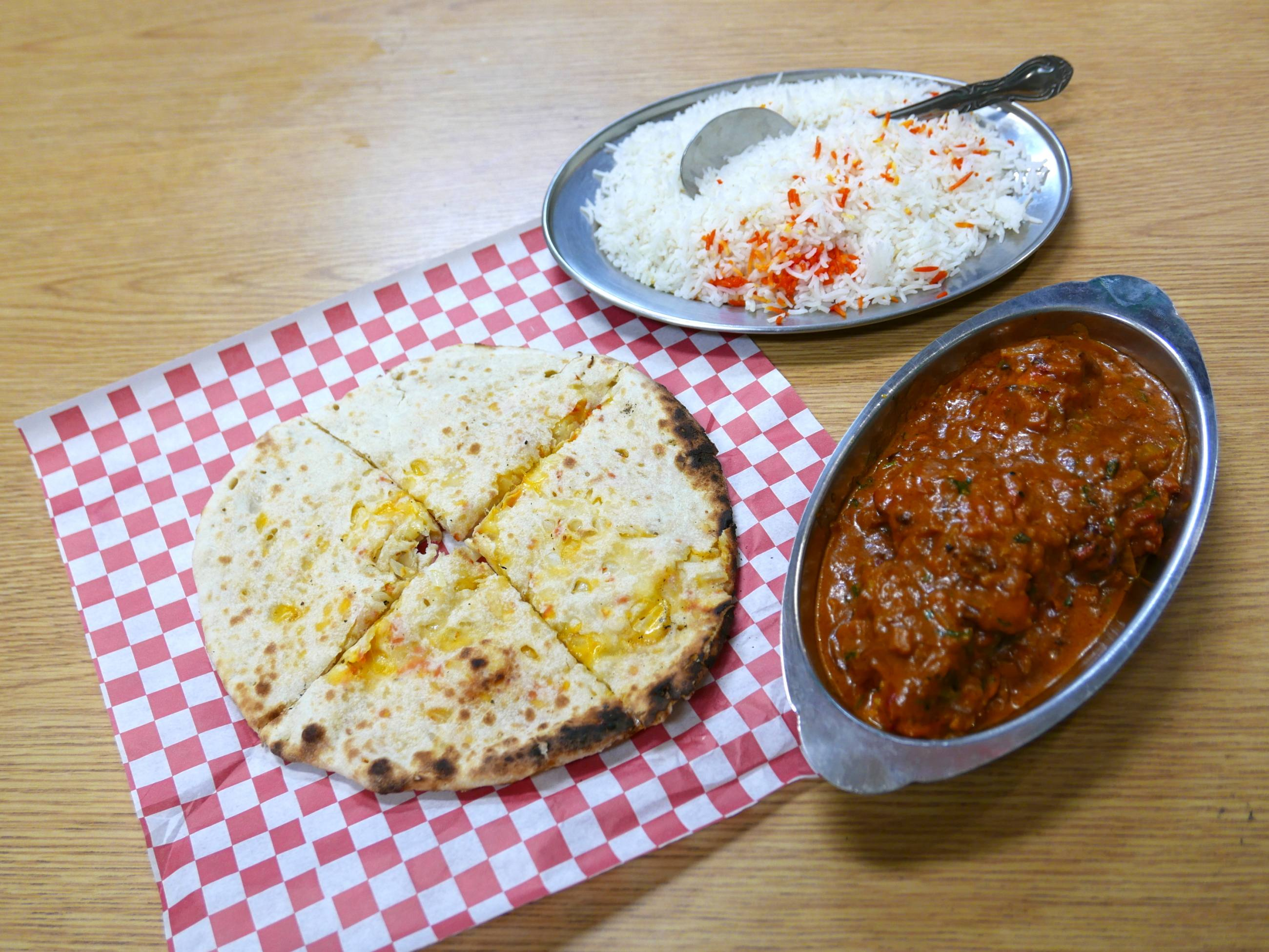 """Chicken roast"" with naan at Amar Desh | Photo: Joshua Lurie"