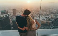 A couple watches the sunset at OUE Skyspace in Downtown LA